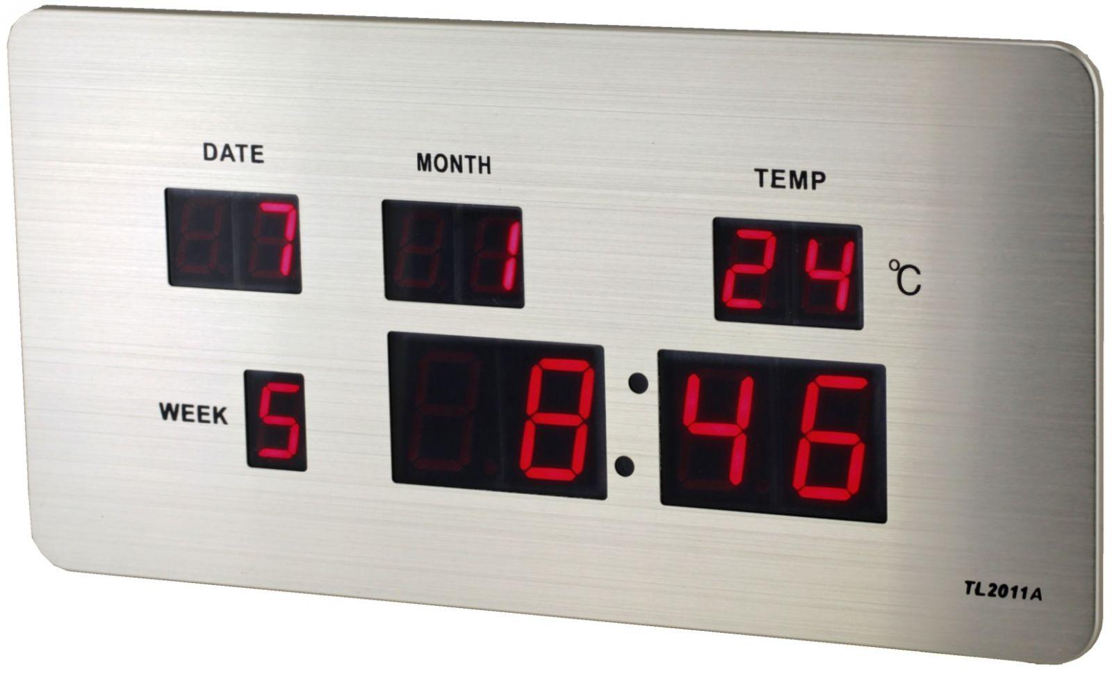 Digitální budík s červenými LED diodami, datem a teploměrem k postavení na stůl nebo pověšení na zeď.086