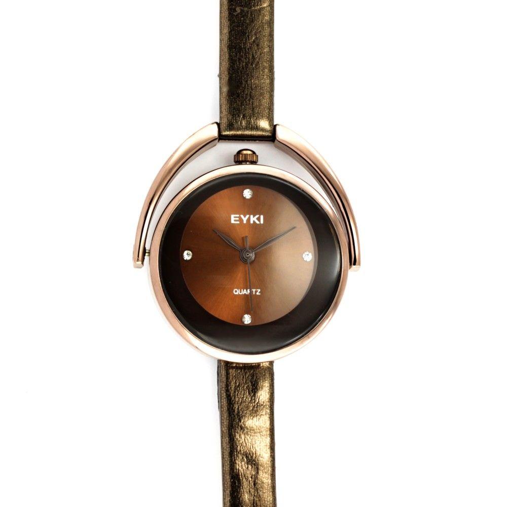 Elegantní dámské hodinky s úzkým lesklým koženým řemínkem a hnědým  číselníkem se zirkony místo indexů. 6351961d62