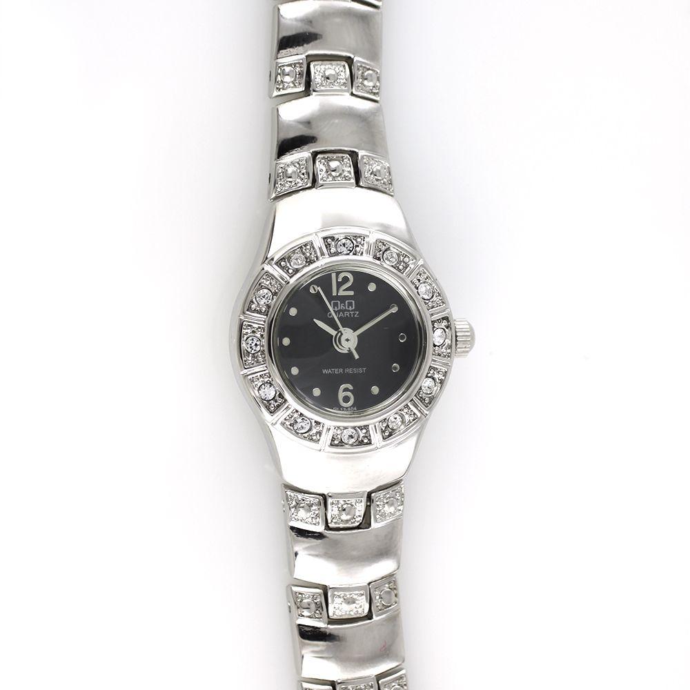 Dámské quartz hodinky s černým číselníkem, zdobené broušenými kamínky..0147 A.Q00I90M70