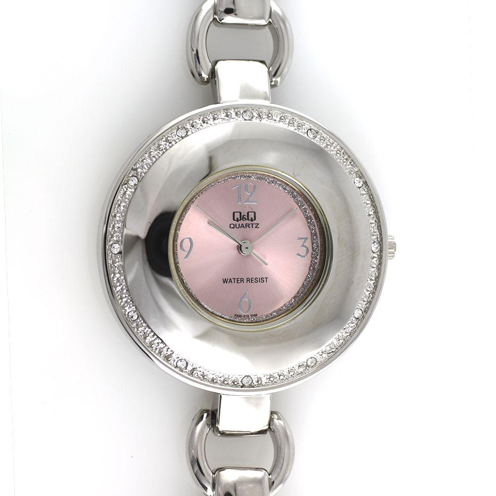 Dámské společenské hodinky s růžovým číselníkem, po obvodu zdobené kamínky..0143