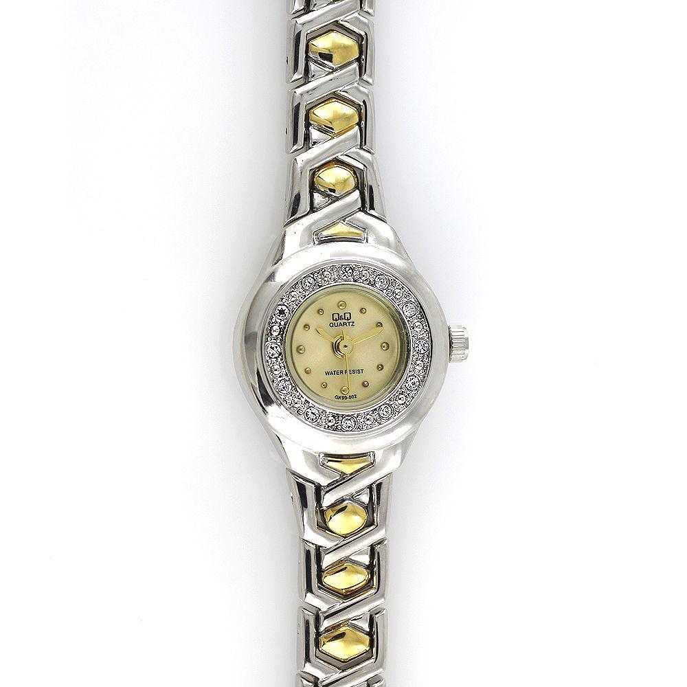 Dámské zdobené hodinky se zlatým číselníkem na kovovém řemínku stříbrno- zlaté barvy..0134 7f6309357f