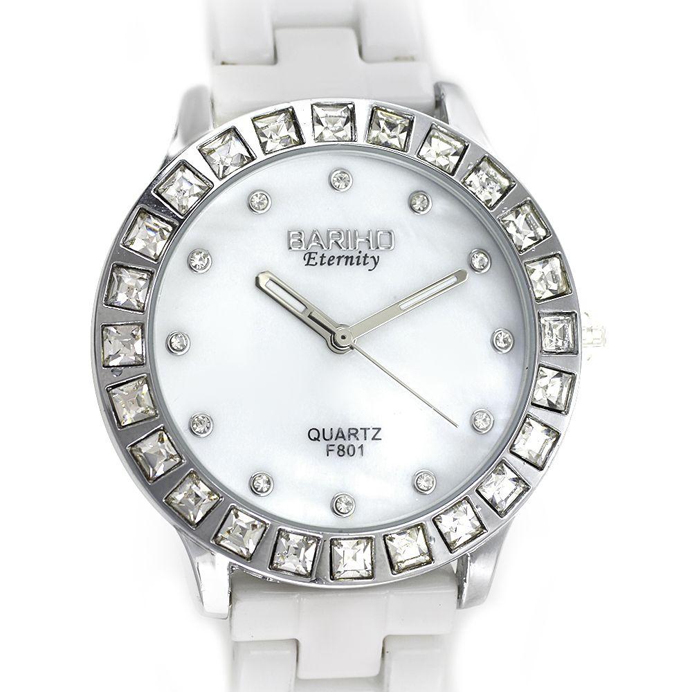Dámské kovové hodinky zdobené po obvodu broušenými kameny na bílém řemínku..0169