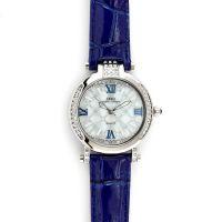 Dámské hodinky se zdobným ciferníkem a kamínky na pouzdře..0500