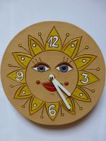 Nástěnné kulaté keramické hodiny - motiv slunce